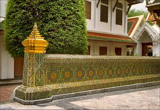 Thai temple art and architecture - The kamphaeng kaeo (crystal wall) surrounding the ubosot at Wat Ratchabophit in Bangkok