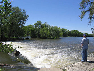 Kankakee River - Fisherman beside dam on the Kankakee River at Momence, Illinois, on the north bank, looking southwest