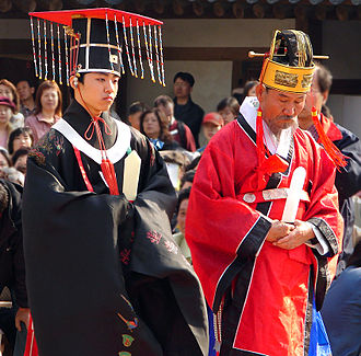 """Society in the Joseon Dynasty - Royal wedding reenactment in the Unhyeongung palace in Seoul, with the """"king"""" on the left"""