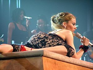 Red Blooded Woman - Minogue performing the song during Showgirl: The Greatest Hits Tour (2005).