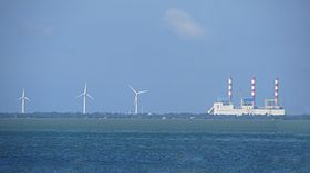 Three wind turbines of the Mampuri Wind Farm, located near the Lakvijaya Power Station.