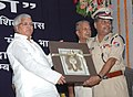 Lalu Prasad receiving a memento from the Director General, Railway Protection Force, Shri M.K. Sinha at the Foundation Stone Laying Ceremony of the Residential Block of Railway Protection Force Officers' Mess, in New Delhi.jpg