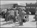 Lone Pine, California. Evacuees from Sacramento change from the train to a bus on their trip to the . . . - NARA - 538493.tif