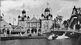 """Luna Park, Cleveland - View of Luna Park, Clevelands shoot-the-chutes ride, ca. 1910. Note the sign for the """"10¢ Infant Incubators"""" in the background."""
