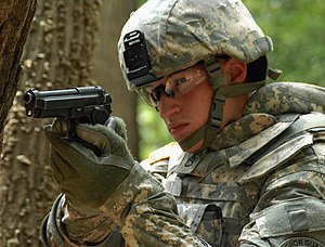 Service pistol - A United States Army soldier in 2009 demonstrates the usage of his Beretta M9 sidearm.