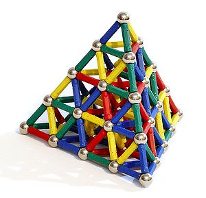 Magnet - Magnets have many uses in toys. M-tic uses magnetic rods connected to metal spheres for construction. Note the geodesic tetrahedron