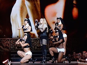 """Holy Water (Madonna song) - Madonna singing a fragment of """"Vogue"""" during the performance of """"Holy Water"""" on the Rebel Heart Tour."""