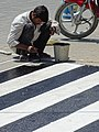 Man Painting Lines on Road - Srinagar - Jammu & Kashmir - India (26803175386).jpg