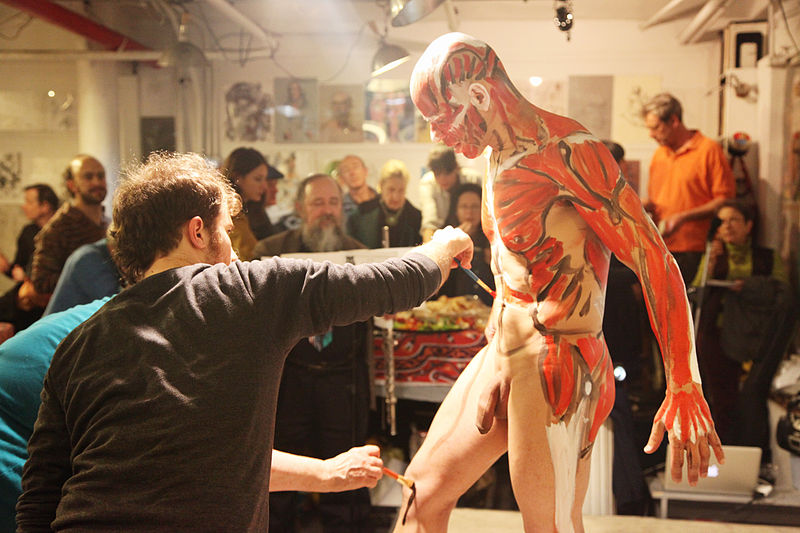 File:Man receiving body paint.jpg