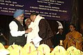 Manmohan Singh felicitating the Prime Minister of Bhutan, Mr. Lyonchhen Jigmi Y. Thinley at the 4th Prof. Hiren Mukerjee Memorial Annual Parliamentary Lecture, at Parliament House, in New Delhi. The Vice President.jpg