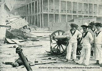 Anglo-Zanzibar War - British sailors pose with a captured cannon outside the sultan's palace