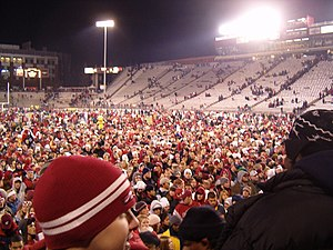 Washington State Cougars - Cougar fans celebrate on the field after an Apple Cup win in 2004.
