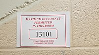Maximum occupancy sign, Ohio University Convocation Center.jpg