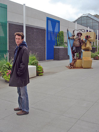 """Censorship in Canada - Ryan McCourt, pictured with his sculpture """"Destroyer of Obstacles,"""" in front of the Shaw Conference Centre in Edmonton, August 2007, a month before the work was ordered removed by Mayor Stephen Mandel."""