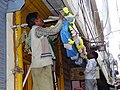 Men Stringing Flowers - Varanasi - Uttar Pradesh - India (12480664064).jpg