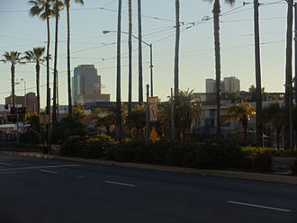 """Blue Line (Los Angeles Metro) - This is where the Metro Blue Line trains cross an """"X"""" intersection in Downtown Long Beach. The Blue Line splits south into one track only for the loop."""