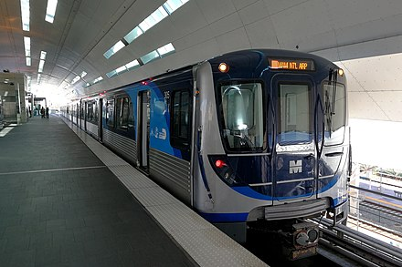 The Metrorail is the city's rapid transit system and connects the city's central core with its outlying suburbs. Miami Metrorail Hitachi train 20190117.jpg