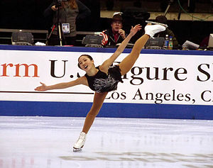 Michelle Kwan - Michelle Kwan performing her signature spiral at a practice session at the 2002 U.S. Figure Skating Championships