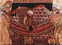 A 1315 image of Muhammad lifting the Black Stone into place, when the Kaaba was rebuilt in the early 600sFor more information on this image, please see Depictions of Muhammad.