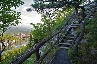 Parts of many hiking trails around Lake Mohonk, New York State, US, include stairways which can prevent erosion Mohonk Mountain House 2011 Hiking Trail against Guest Rooms 2 FRD 3281.jpg