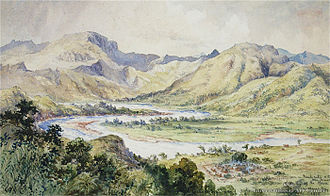 Taukei ni Waluvu - Nairukuruku Village in foreground, on Christmas Day 1875. Artist: Constance Gordon-Cumming (1837–1924).  Looking south-west from Taulevu ridge with Wainimala river flowing from right to left. Highest feature is Nariko peak in left farground. Other features shown are Nacau and Ulira peaks in right mid-ground. Established a few years earlier after re-locating from Navaulele, the village is surrounded by a dry moat. The large bure within the village is the church. Notably two homesteads outside the village to the west are that of the native minister and Ratu Viliame Batiratu's residence by the river named yavu- ni-turaga levu.Today, with a population of 300, five mataqalis or clans reside together in Nairukuruku village. They are namely: Siko Natabutale (chiefly clan), Nawaita (warriors), Nabubuco (chief's elders), Nakorowaqa (heralds), and Navitilevu (warriors).