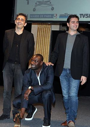 The Intouchables - Directors Olivier Nakache & Éric Toledano with star Omar Sy at the 2012 Lumière Film Festival.