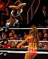 Naomi applying a Diving Crossbody on Nikki Bella.jpg