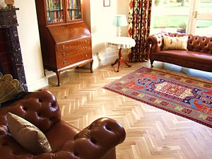 Wood flooring - Oak herringbone parquet floor with two-strip wenge border