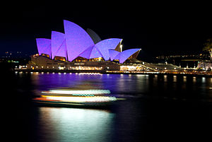 Opera Australia - The Sydney Opera House, home of Opera Australia, illuminated at night.