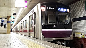 Osaka Municipal Subway - Top: 10 series and 21 series trains on the Midōsuji Line.   Bottom: A 30000 series train on the Tanimachi Line.