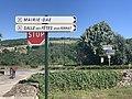 Panneau indiquant la salle des fêtes Jean Ferrat à Lupé.jpg