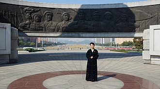 Party Foundation Day - A tour guide visiting the Monument to Party Founding in Pyongyang around the anniversary