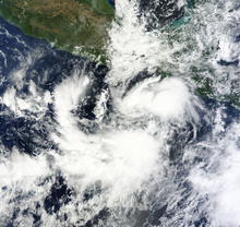 Satellite image of a weak tropical depression over open waters south of Mexico. The system features disorganized cloud cover that spirals inward toward the storm's center.