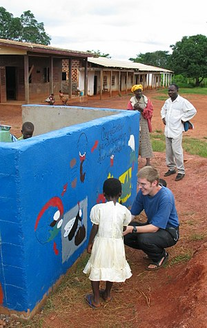 A Peace Corps Volunteer helps Cameroonian chil...