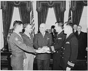 Photograph of President Truman joining hands with four servicemen he has just decorated with the Medal of Honor... - NARA - 199310.jpg