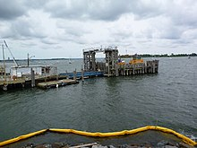 A ferry pier jutting into the water from the left-hand side of the image