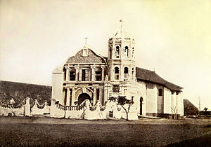 Our Lady of Porta Vaga - The Ermita de Porta Vaga (Chapel of Porta Vaga) alongside the walls of Cavite, built as the original shrine of Our Lady of Solitude of Porta Vaga, c. 1899.