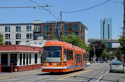 Car 002, one of the five cars that opened the system in 2001, on NW Northrup Street at 19th Avenue, which is on that 2001-opened route section Portland Skoda tram 002 westbound on Northrup St at 19th Ave in 2019.jpg