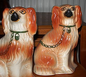 Staffordshire dog figurine - Staffordshire spaniels. (Not a matching pair as a correct pair would face in opposite directions.)
