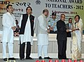 Pranab Mukherjee presenting the National Award for Teachers-2012 to Smt. Lily Handique, Assam, on the occasion of the 'Teachers Day', in New Delhi. The Union Minister for Human Resource Development.jpg