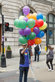 Pride in London 2016 - A man in a LinkedIn LGBT t-shirt with branded balloons.png