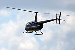 Private, ES-HRG, Robinson R44 Raven (18393145425).jpg
