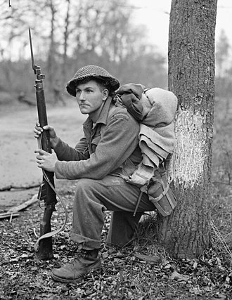 The Perth Regiment - Private K.O. Earl of the Perth Regiment resting in the forest north of Arnhem, Netherlands, April 15, 1945