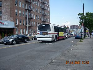 Triboro Coach - Rear view of an MTA Bus Company bus on the Q38 route with Triboro Coach colors.