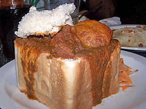 South African cuisine - An example of bunny chow, served in Durban, KwaZulu-Natal.