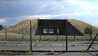 concrete missile silo covered in grass