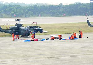 ROCA Dragon Team Parachuters Encloseing Suits at Hukou Camp Ground 20111105.jpg