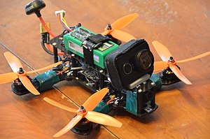 Drone racing - Minion 220 racing multirotor, with motors still warm and one propeller with one of its four blades missing after a long flying session.