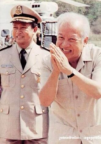 FUNCINPEC - Norodom Sihanouk with his son and ANS commander-in-chief, Norodom Ranariddh during an ANS inspection tour during the 1980s.