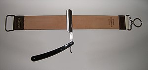 Razor strop - A straight razor with a hanging strop.